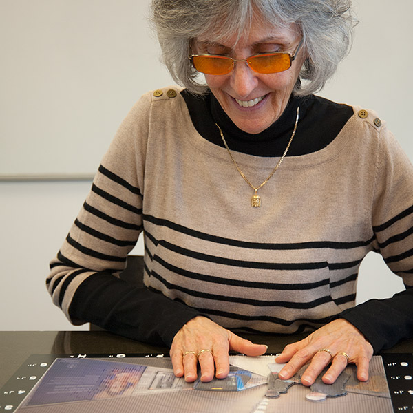 Deaf-blind Graciela Gonzalo-Sundström examines a tactile photograph by Rolf Eriksson